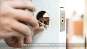 take the wire under the deadbolt